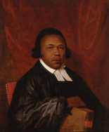 "Born a slave in 1746, Absalom Jones came to be regarded (along with Richard Allen -- see ""Portrait of Richard Allen"") as one of the leaders of Philadelphia's vibrant African American community. Jones bought his own freedom as well as that of his wife's through years of hard work, and went on to found the Free African Society with Richard Allen, and eventually led the African Church of St. Thomas in Philadelphia, the first black Episcopal church in the United States. The most widely recognized image of the Reverend Absalom Jones, completed sometime prior to the winter of 1810, displays a dignity rarely allowed African subjects in 19th century art. The portrait, which focuses on Jones's face and upper body, shows Jones in his ecclesiastical robes, with Bible in hand, emphasizing his role in the African American religious community. While the style is simple, it is reminiscent of formal paintings of European clergy. This refined style was a concerted product of the painter,  Raphaelle Peale, the oldest surviving child of the prominent Philadelphia portraitist Charles Willson Peale. The senior Peale was pleased to discover that his son had ""painted a Portrait in oil of Absalom Jones a very excellent picture of the Rev'd. Gentleman."""
