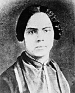 Mary Ann Shadd Cary was a prominent nineteenth-century abolitionist and women's rights advocate in the United States and Canada. Born into a prominent free black family in Wilmington, Delaware, Cary grew up in a household dedicated to abolition. After the passage of the Fugitive Slave Act in 1850, Cary relocated to Canada, where she started the first black female-run newspaper, the  Provincial Freeman . After the abolition of slavery and the end of the Civil War, Cary attended Howard Law School in Washington, D.C., becoming the first African American woman to receive a J.D. In this portrait, Cary exudes restrained refinement, with subdued colors, pressed garments, and meticulously styled hair. Her exceptionally strong gaze, looking just to the left of the camera, projects her resolve and resilience in the fight against slavery and injustice.