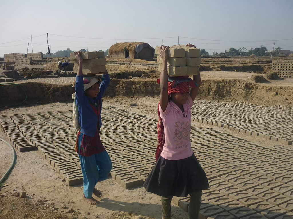 Up to 1.7million children from the age of five are working in illegal brick factories in Pakistan . They work up to 14 hours a day with little food, no sanitation and little pay